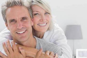 Older man and woman smiling | Dentist 98272