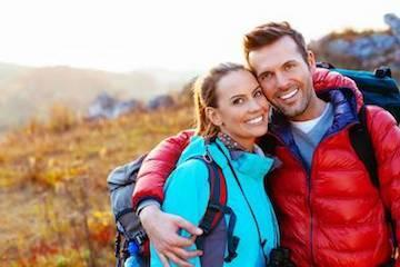 smiling couple hiking