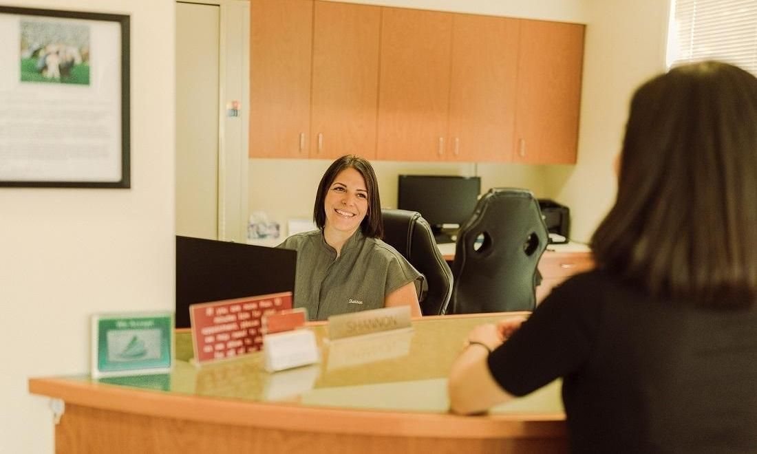 Our front office coordinator Shannon greets a patient